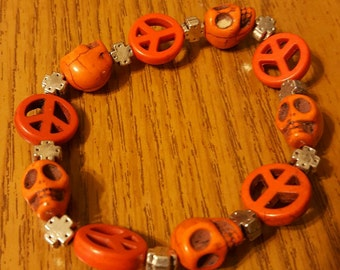 Orange skull and peace sign bracelet