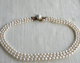 Vintage Feshwater pearls necklace ~ silver clasp stamped ~ three strands  A1963
