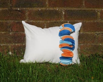 Origami Inspired White Cushion with 3D Applique Detail in blue and orange