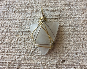 Wire wrapped sea glass pendant • brass & copper wire • clear/foggy sea glass