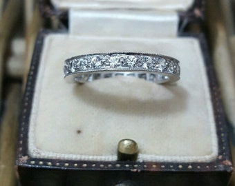 Vintage solid silver eternity ring with white topaz, size O