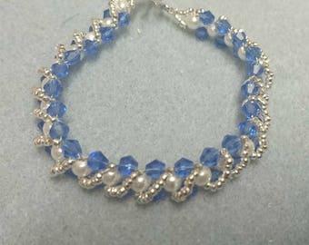 Blue, white and silver beaded bracelet