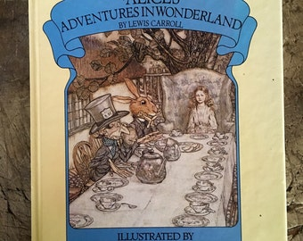 Alice in Wonderland ,1980s Alice book ,Lewis Carroll ,Arthur Rackham,  white rabbit , mad hatter , tea party