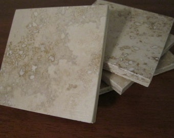 Set of 4 natural travertine coasters. Beautiful natural stone colors in darker browns and tans!