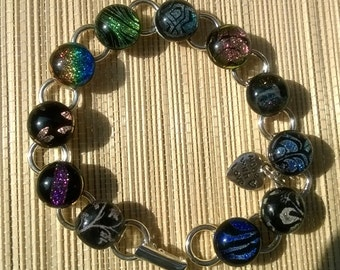 """Black fused glass multi patterned dichroic button bracelet, kiln fired, UK,unique, Christmas, gift,  7 1/2"""", and gift boxed."""