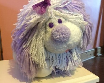 Vintage fluppy dog plushy in purple and white