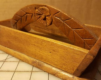 Handcrafted, wood carved basket with flower motif.
