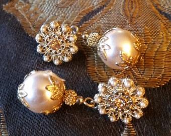Gold tone drop pearl earrings