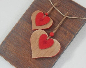 Pair of wooden hearts valentines hanging on wood panel-pair of wooden hearts valentine hanging on wood panel-Home Decor