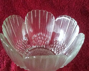 Clear glass flower petal bowl / candle holder with textured, raised details on outside of the bowl