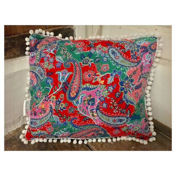 paisley print pom pom cushion