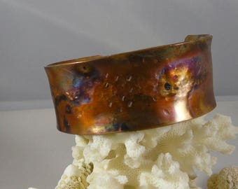 Lovely Solid copper ,flame  patina, and distressed Boho cuff.