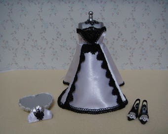 A beautiful white and black miniature evening dress on a mannequin.
