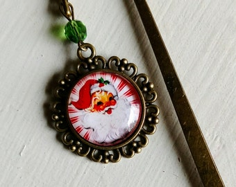 Vintage Santa brass book hook bookmark with dangling glass cabochon accent