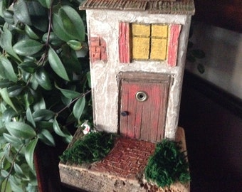 253 - hand crafted ornamental fairy house for home or garden decor.