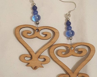 Sankofa wood carved earrings with bead accents.