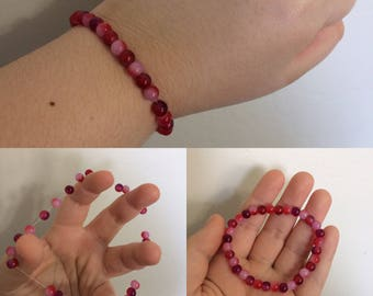 Red, Pink, and Magenta Beaded Bracelet