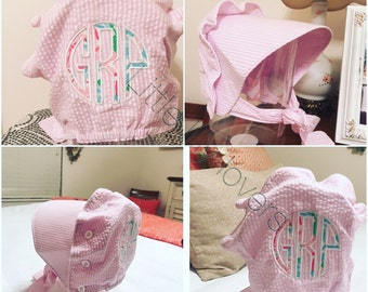 Baby toddler infant child monogrammed sun bonnet with lilly pulitzer applique monogram. Also available in white organic cotton.