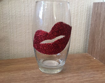 Red lips glitter glass