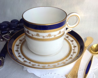 Antique Royal Worcester Demitasse and Saucer, Cobalt Blue, White, Raised Gold, Bone China, Made in England, 1906.