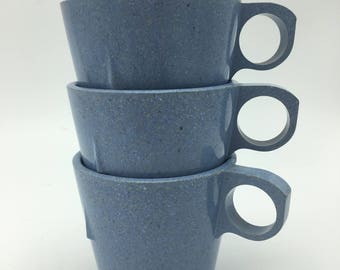 Blue splatterware style melamine stacked mugs marked 1986 . Vintage
