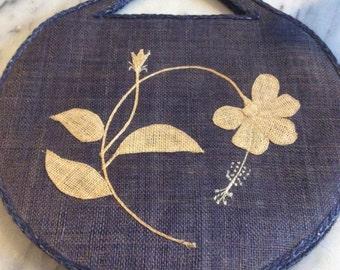 Vintage Navy Blue Woven Resort Handbag with natural color flower detail