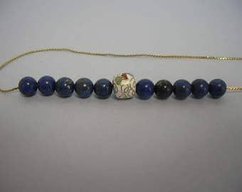 A necklace of blue and gold
