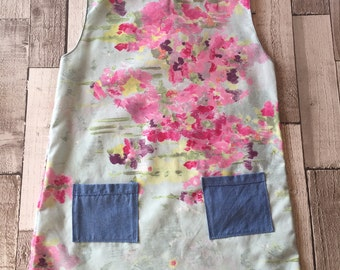 Homemade girls floral pattern dress with matching bow clip