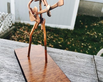 Copper Art Figurine of a guitarist / bass