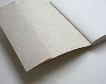 Coptic Stitched Journal with Handmade Paper Elements.