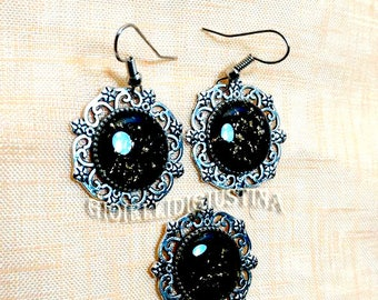 Gemstone earrings and black resin pendant with golden leaves