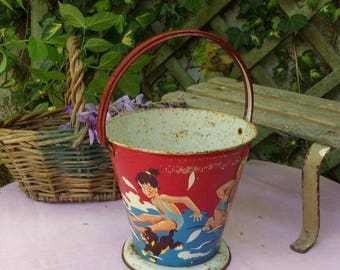 lovely vintage or antique Beach bucket