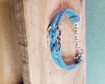 Leather Bracelet woven in 4 silver rings.