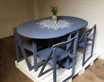 Grey dining room table with mandala design, collapsible, fold down, fold away