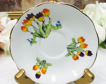 "Royal Albert Crown China ""Tulip"" orphan saucer."