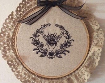 Laurel and Napoleonic Bee...framed in wooden hoop...machine embroidery