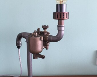 Unique steampunk industrial pipe lamp.