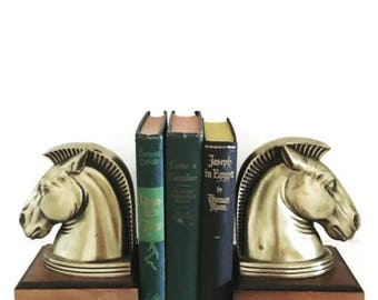 Vintage horse head bookends. / midcentury / gold