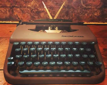 Vintage collectible Smith-Corona Skyriter typewriter with original case