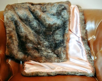 Faux fur wrap with pink lining