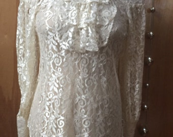 Vintage sheer lace long sleeved short with  jabot, size medium.