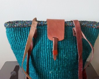 Green hand made woven handbag