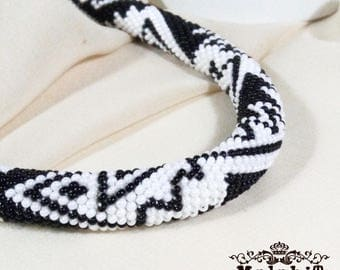 Bead crocheted necklace in black and  white colors. Classic and Elegant.  Silver plated accessories. Peru Fish.