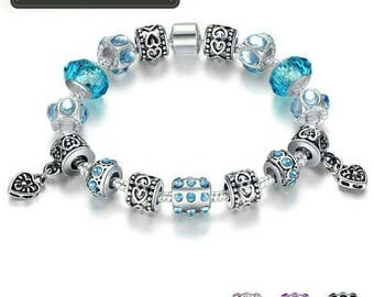 European style silver crystal charm bracelet with blue murano glass beads