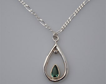 Green Tourmaline and Diamond Pendant in Sterling Silver Fine Silver 14k Yellow Gold and 14k White Gold on sterling silver 16 inch Chain