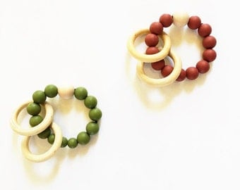 Maroon and army green teething ring/ rattles baby toys