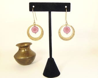 Mauve Czech glass Hibiscus flower bead with decorative brass ring, and large brass ear wires.
