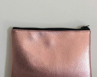 Metallic rose gold faux leather clutch bag