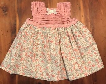 Pink crochet and floral dress size 0-3 months.