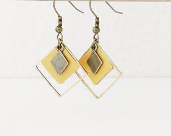 Earrings were triple diamond spring yellow dahlia leather and brass